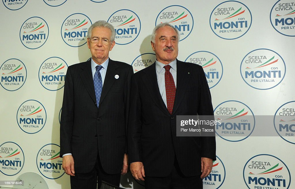 Italian Prime Minister <a gi-track='captionPersonalityLinkClicked' href=/galleries/search?phrase=Mario+Monti&family=editorial&specificpeople=632091 ng-click='$event.stopPropagation()'>Mario Monti</a> stands with Alberto Bombassei during a convention for his centrist alliance 'With Monti For Italy' (Con Monti Per L'Italia) at Kilometro Rosso on January 20, 2013 in Bergamo, Italy. Monti used the rally to unveil the list of candidates for the 'Civic Choice' (Scelta Civica) movement, a bloc that will form part of the centrist alliance running in February's parliamentary elections.