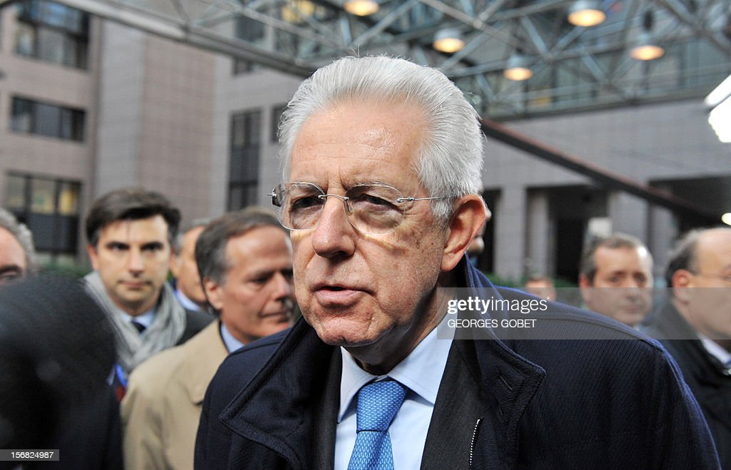 Italian Prime Minister Mario Monti talks to journalists as he arrives at the EU Headquarters on November 22, 2012 in Brussels, to take part in a two-day European Union leaders summit called to agree a hotly-contested trillion-euro budget through 2020. European Union officials were scrambling to find an all but impossible compromise on the 2014-2020 budget that could successfully move richer nations looking for cutbacks closer to poorer ones who look to Brussels to prop up hard-hit industries and regions.