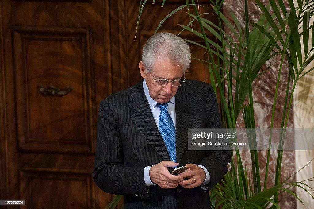 Italian Prime Minister <a gi-track='captionPersonalityLinkClicked' href=/galleries/search?phrase=Mario+Monti&family=editorial&specificpeople=632091 ng-click='$event.stopPropagation()'>Mario Monti</a> uses mobile phone as he waits for Jia Qinglin, Chairman of the National Committee of the Chinese People's Political Consultative Conference, prior a meeting at Palazzo Chigi on November 28, 2012 in Rome, Italy. Jia Qinglin is on a three country tour that also includes Costa Rica and Argentina.