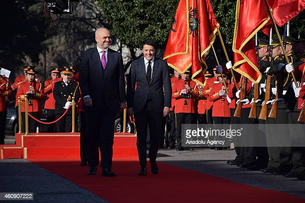 Italian Prime Minister Matteo Renzi and Albanian Prime Minister Edi Rama walk together during a welcoming ceremony in Tirana Albania on December 30...