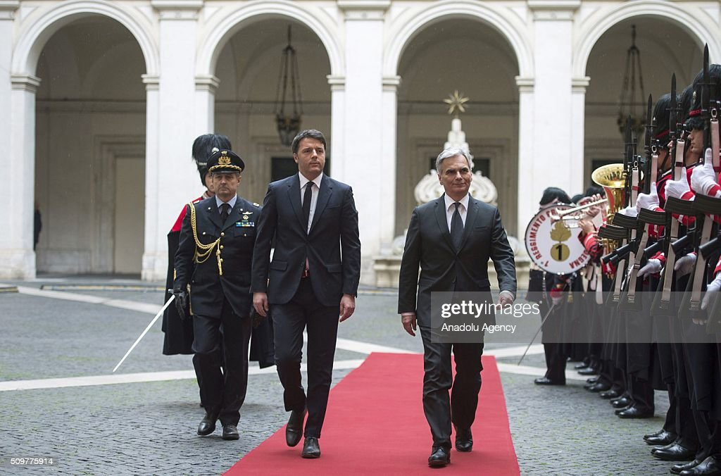 Italian Prime Minister Matteo Renzi (L) and Austrian Chancellor Werner Faymann walk past the guard of honor during an official welcoming ceremony at the Palazzo Chigi in Rome, Italy on February 12, 2016. (Photo by Tiberio Barchielli / Italian Prime Ministry (Palazzo Chigi)/Anadolu Agency/Getty Images)