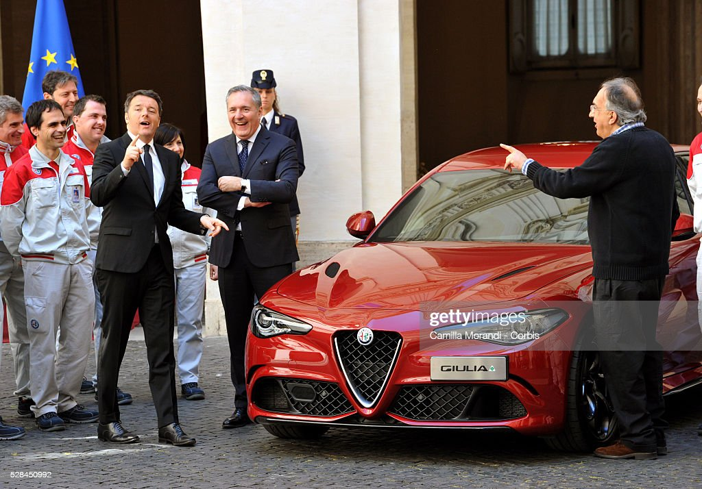 Italian Prime Minister <a gi-track='captionPersonalityLinkClicked' href=/galleries/search?phrase=Matteo+Renzi&family=editorial&specificpeople=6689301 ng-click='$event.stopPropagation()'>Matteo Renzi</a> and CEO of Fiat Chrysler Automobiles <a gi-track='captionPersonalityLinkClicked' href=/galleries/search?phrase=Sergio+Marchionne&family=editorial&specificpeople=608333 ng-click='$event.stopPropagation()'>Sergio Marchionne</a> attend the unveiling of Italian car manufacturer Alfa Romeo's latest car The Alfa Romeo Giulia on May 5, 2016 in Rome, Italy.