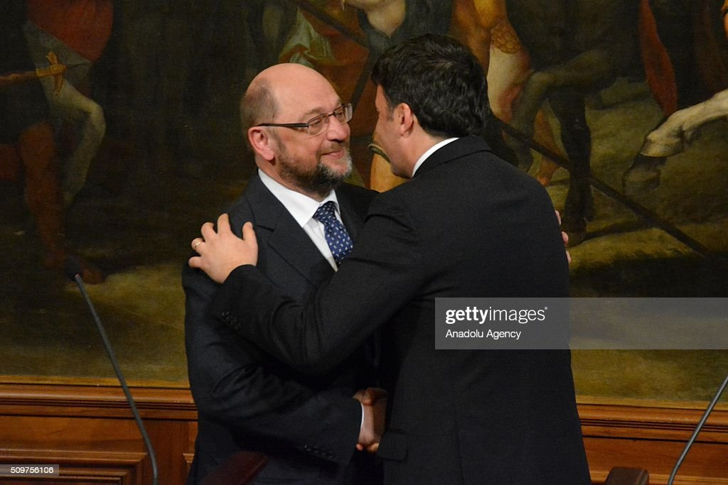 Italian Prime Minister Matteo Renzi (R) and European Parliament President Martin Schulz (L) shake hands of each other at the end of their press conference at Chigi palace in Rome, Italy on February 12, 2016.