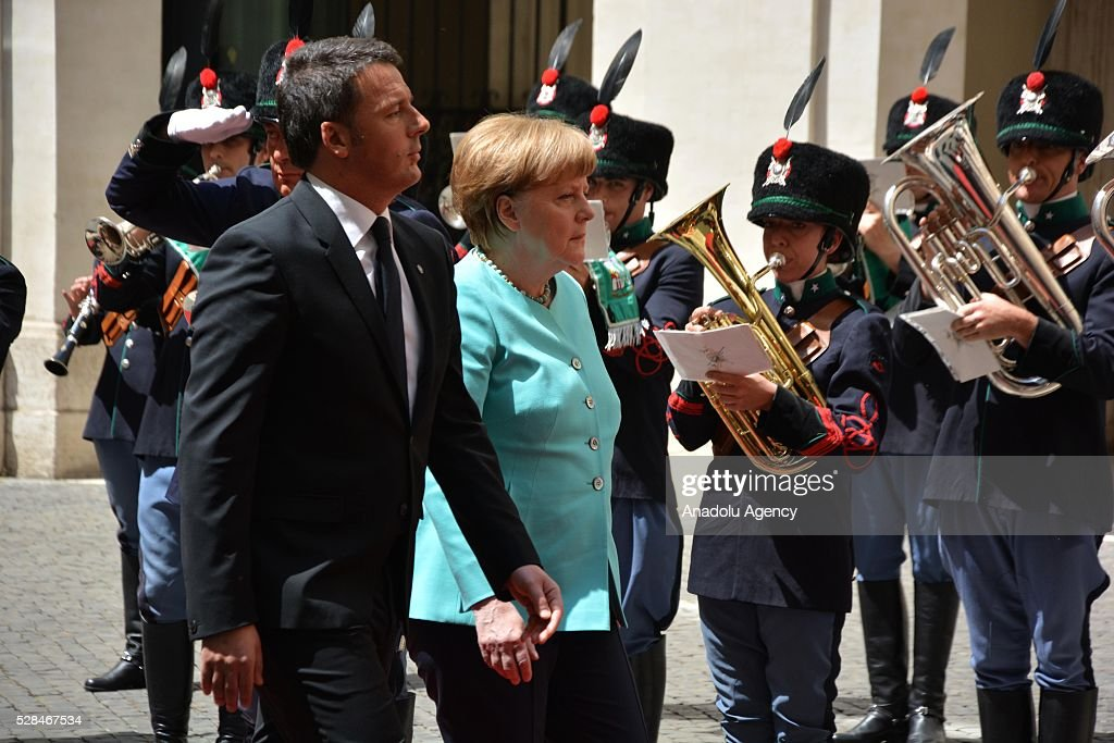 Italian Prime Minister Matteo Renzi (L) and German Chancellor Angela Merkel inspect Italian honor guards during an official welcoming ceremony in Rome, Italy, 05, 2016. Merkel is on a two-day visit to Rome.