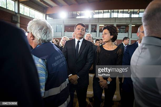 Italian Prime Minister Matteo Renzi and his wife Agnese Landini attend a funeral mass for victims of earthquake on August 27 2016 in Ascoli Piceno...