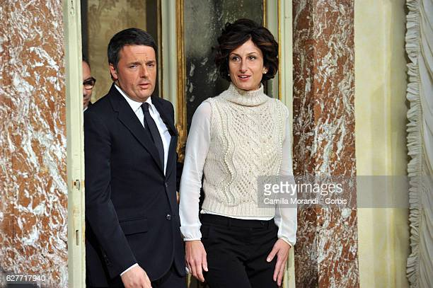 Italian Prime Minister Matteo Renzi and his wife Agnese Landini attend a press conference to acknowledge defeat in a constitutional referendum and...