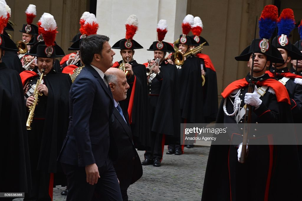 Italian Prime Minister Matteo Renzi (R) and Iraqi Prime Minister Haider al-Abadi (R) inspect the Honor guards during the official welcoming ceremony at Chigi palace in Rome, Italy on February 10, 2016.