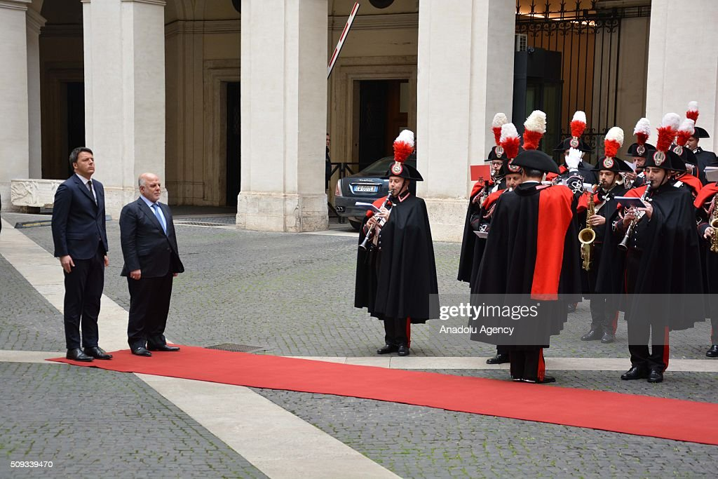 Italian Prime Minister Matteo Renzi (L) and Iraqi Prime Minister Haider al-Abadi (R) stand in silence during the official welcoming ceremony at Chigi palace in Rome, Italy on February 10, 2016.