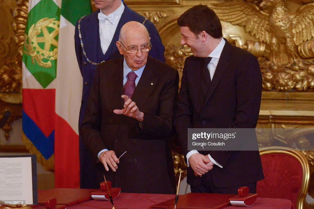 Italian Prime Minister <a gi-track='captionPersonalityLinkClicked' href=/galleries/search?phrase=Matteo+Renzi&family=editorial&specificpeople=6689301 ng-click='$event.stopPropagation()'>Matteo Renzi</a> (R) and Italy's Presidenton <a gi-track='captionPersonalityLinkClicked' href=/galleries/search?phrase=Giorgio+Napolitano&family=editorial&specificpeople=568986 ng-click='$event.stopPropagation()'>Giorgio Napolitano</a> attend the swearing in ceremony of the new government at Quirinale Palace on February 22, 2014 in Rome, Italy. Newly designated 39-year-old Prime Minister <a gi-track='captionPersonalityLinkClicked' href=/galleries/search?phrase=Matteo+Renzi&family=editorial&specificpeople=6689301 ng-click='$event.stopPropagation()'>Matteo Renzi</a> is the youngest leader in Italy's 163-year history as a united country.