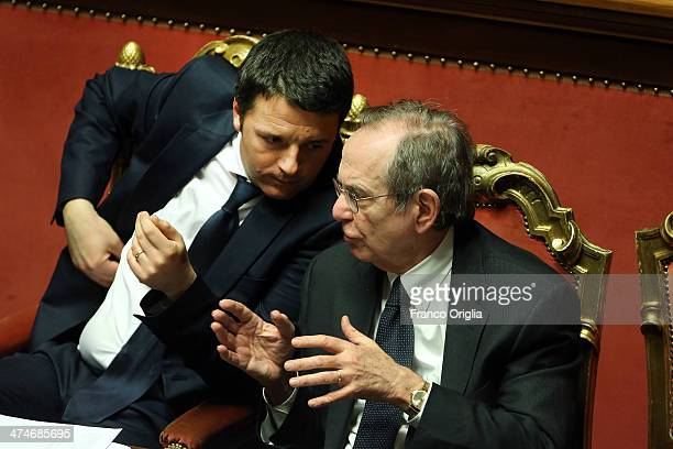 Italian Prime Minister Matteo Renzi and Minister of Economy and Finance Pier Carlo Padoan attend a debate ahead of a confidence vote on Renzi's...