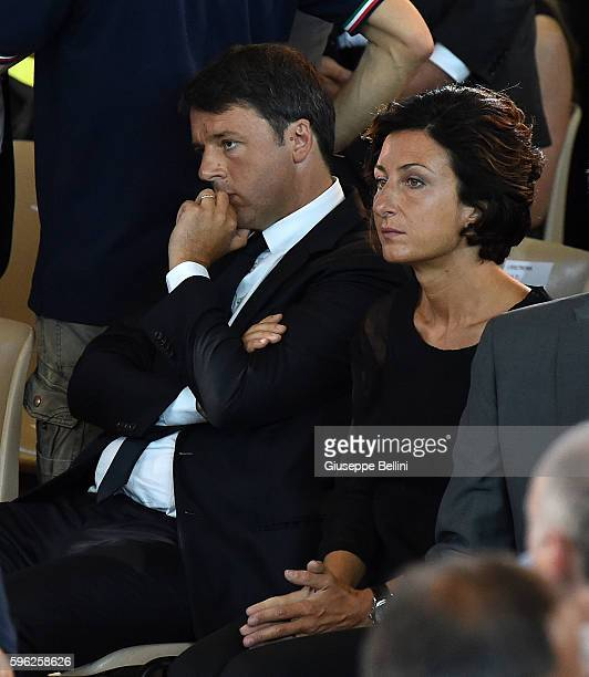 Italian Prime Minister Matteo Renzi and wife Agnese Landini attend a funeral mass for victims of the recent Italian earthquake on August 27 2016 in...