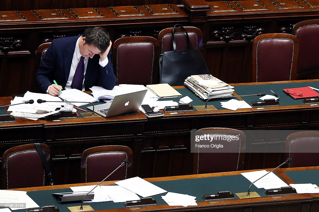 Italian Prime Minister <a gi-track='captionPersonalityLinkClicked' href=/galleries/search?phrase=Matteo+Renzi&family=editorial&specificpeople=6689301 ng-click='$event.stopPropagation()'>Matteo Renzi</a> attends a debate ahead of a confidence vote on his coalition government at the Italian Chamber Of Deputies at Montecitorio Palace on February 25, 2014 in Rome, Italy. Renzi, 39, is the youngest prime minister in the country's history.