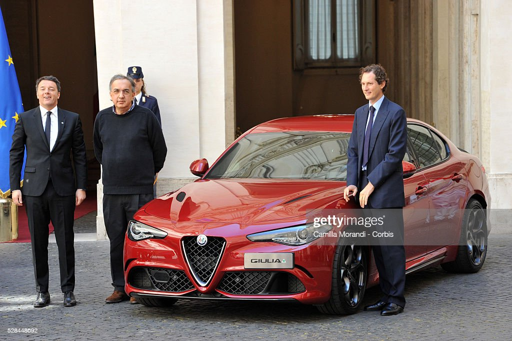 Italian Prime Minister <a gi-track='captionPersonalityLinkClicked' href=/galleries/search?phrase=Matteo+Renzi&family=editorial&specificpeople=6689301 ng-click='$event.stopPropagation()'>Matteo Renzi</a>, CEO of Fiat Chrysler Automobiles <a gi-track='captionPersonalityLinkClicked' href=/galleries/search?phrase=Sergio+Marchionne&family=editorial&specificpeople=608333 ng-click='$event.stopPropagation()'>Sergio Marchionne</a> and Chairman of Fiat Chrysler Automobiles <a gi-track='captionPersonalityLinkClicked' href=/galleries/search?phrase=John+Elkann&family=editorial&specificpeople=571803 ng-click='$event.stopPropagation()'>John Elkann</a> attend the unveiling of Italian car manufacturer Alfa Romeo's latest car The Alfa Romeo Giulia on May 5, 2016 in Rome, Italy.