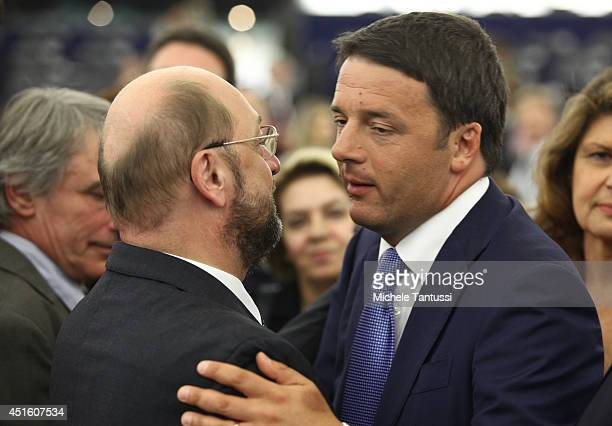 Italian Prime Minister Matteo Renzi chats with Martin Schulz president of the EU Parliament after his speech to the plenary room in the European...