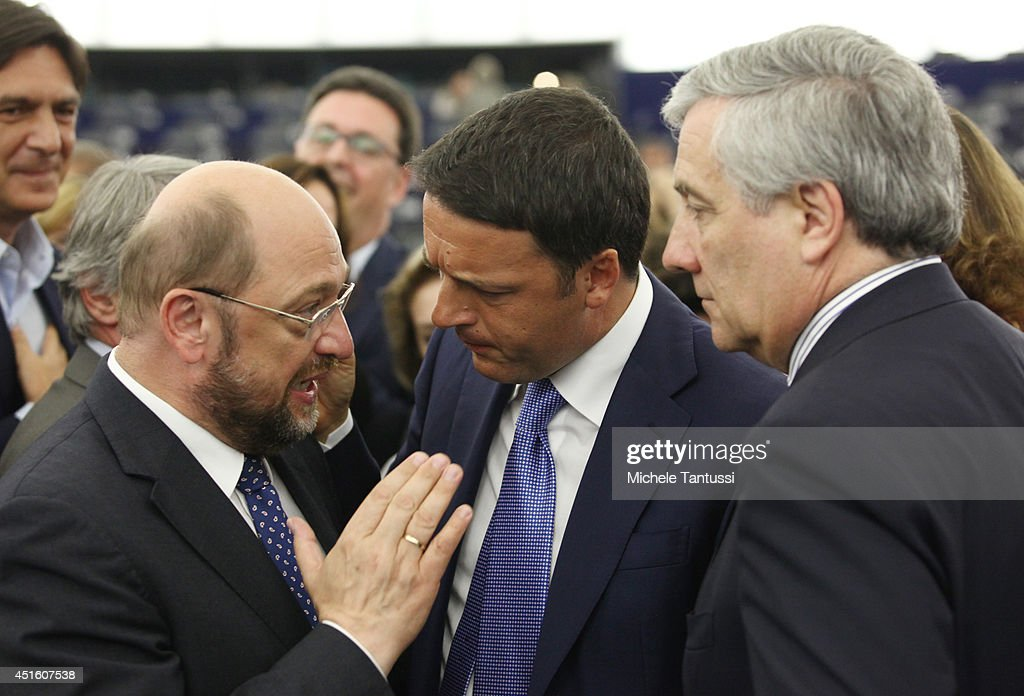 Italian Prime Minister <a gi-track='captionPersonalityLinkClicked' href=/galleries/search?phrase=Matteo+Renzi&family=editorial&specificpeople=6689301 ng-click='$event.stopPropagation()'>Matteo Renzi</a> (C) chats with <a gi-track='captionPersonalityLinkClicked' href=/galleries/search?phrase=Martin+Schulz&family=editorial&specificpeople=598638 ng-click='$event.stopPropagation()'>Martin Schulz</a> (L) president of the EU Parliament and <a gi-track='captionPersonalityLinkClicked' href=/galleries/search?phrase=Antonio+Tajani&family=editorial&specificpeople=5429212 ng-click='$event.stopPropagation()'>Antonio Tajani</a> (R) after his speech to the plenary room in the European Parliament ahead of the beginning of the six-month Italian presidency of the European council on July 2, 2014 in Strasbourg, France. The European parliament convened yesterday for the first time since the European elections which saw a surge in non-affiliated Eurosceptic MEP's. The German Socialist Schulz will serve a second term as president of the European Parliament even though the European People's Party (EPP) won the most seats in the European Union assembly.