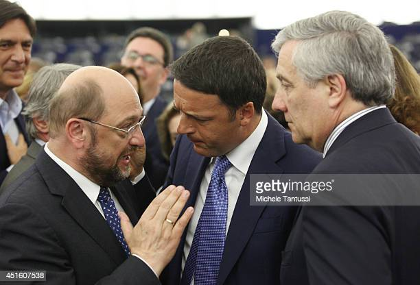 Italian Prime Minister Matteo Renzi chats with Martin Schulz president of the EU Parliament and Antonio Tajani after his speech to the plenary room...