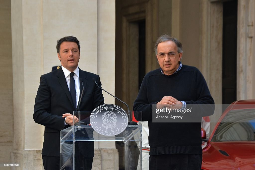 Italian Prime Minister Matteo Renzi (C) delivers a speech as FCA's CEO Sergio Marchionne (R) stands next to him during Italian automotive company Fiat-Chrysler Group (FCA) introduces Alfa Romeo's new brand sports car 'Giulia' with a ceremony at the yard of Chigi palace in Rome, Italy on May 5, 2016.