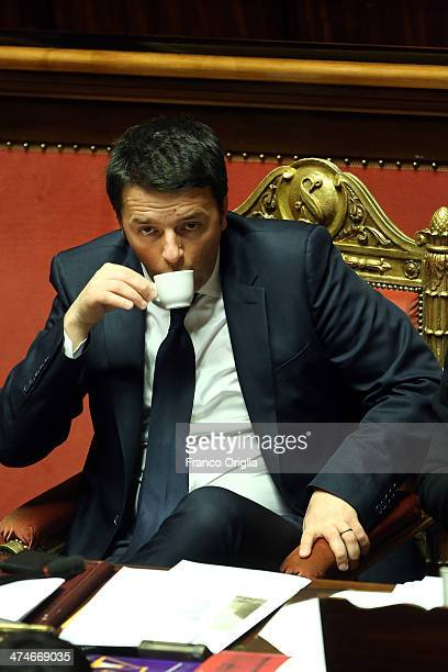 Italian Prime Minister Matteo Renzi drinks an expresso coffe as he attends a debate ahead of a confidence vote for his coalition government at the...