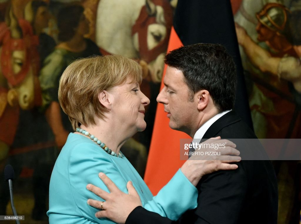 Italian Prime Minister Matteo Renzi (R) embraces with German Chancellor Angela Merkel after a press conference at Rome's Palazzo Chigi on May 5, 2016. EU president Donald Tusk travels to Rome Thursday with fellow EU institution leaders and German Chancellor Angela Merkel for two days of talks likely to focus on next steps in Europe's migrant crisis. Prime Minister Matteo Renzi, who fears Italy becoming the new migrant frontline after the closure of the Balkan route, will host the first day of talks, followed by Pope Francis on Friday. PIZZOLI