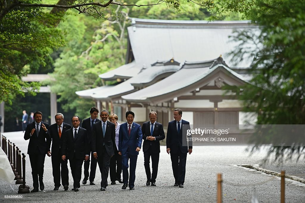 Italian Prime Minister Matteo Renzi, European Commission President Jean-Claude Juncker, French President Francois Hollande, Canadian Prime Minister Justin Trudeau, US President Barack Obama, German Chancellor Angela Merkel, Japan's Prime Minister Shinzo Abe, European Council President Donald Tusk and Britain's Prime Minister David Cameron walk the grounds at Ise-Jingu Shrine in the city of Ise in Mie prefecture, on May 26, 2016 on the first day of the G7 leaders summit. World leaders kick off two days of G7 talks in Japan on May 26 with the creaky global economy, terrorism, refugees, China's controversial maritime claims, and a possible Brexit headlining their packed agenda. / AFP / STEPHANE