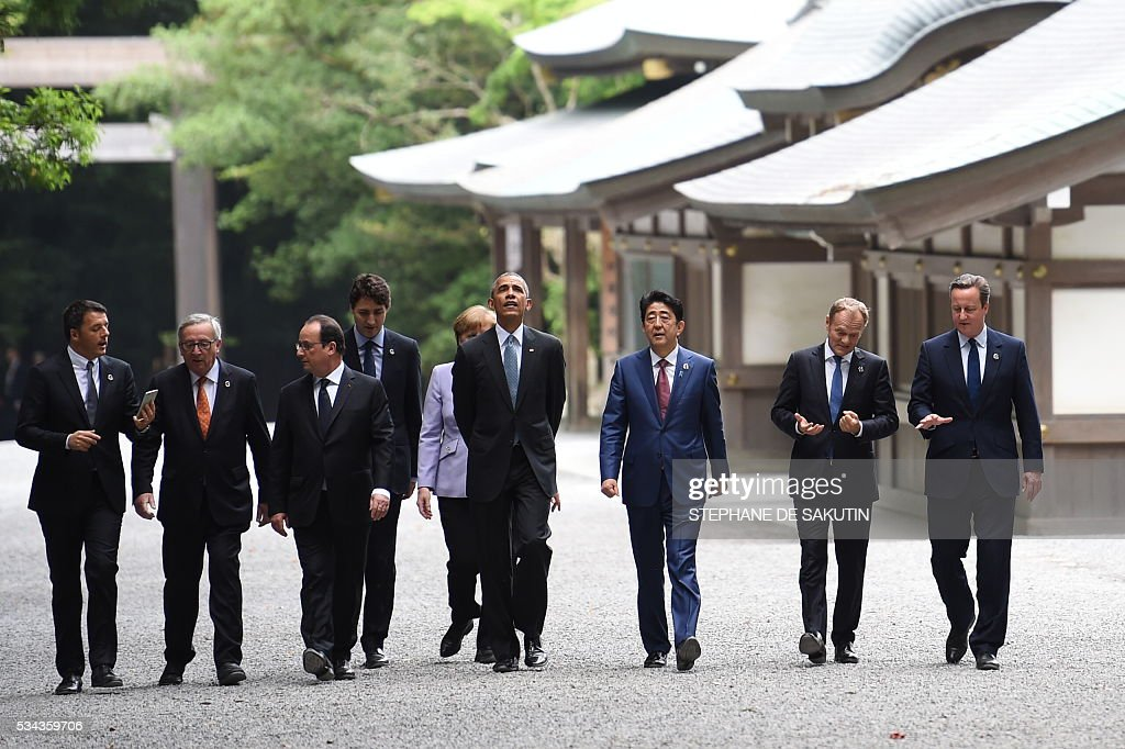 Italian Prime Minister Matteo Renzi, European Commission President Jean-Claude Juncker, French President Francois Hollande, Canadian Prime Minister Justin Trudeau, German Chancellor Angela Merkel, US President Barack Obama, Japan's Prime Minister Shinzo Abe, European Council President Donald Tusk and Britain's Prime Minister David Cameron walk the grounds at Ise-Jingu Shrine in the city of Ise in Mie prefecture, on May 26, 2016 on the first day of the G7 leaders summit. World leaders kick off two days of G7 talks in Japan on May 26 with the creaky global economy, terrorism, refugees, China's controversial maritime claims, and a possible Brexit headlining their packed agenda. / AFP / STEPHANE