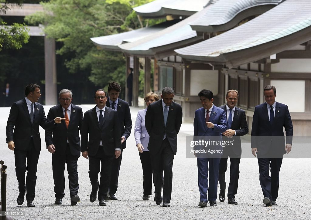 Italian Prime Minister Matteo Renzi, European Commission President Jean-Claude Juncker, French President Francois Hollande, Canadian Prime Minister Justin Trudeau, German Chancellor Angela Merkel, US President Barack Obama, Japanese Prime Minister Shinzo Abe, European Council President Donald Tusk and British Prime Minister David Cameron walk past the Kaguraden as they visit Ise-Jingu Shrine during the first day of the G7 leaders summit in the city of Ise in Mie prefecture, Japan on May 26, 2016.