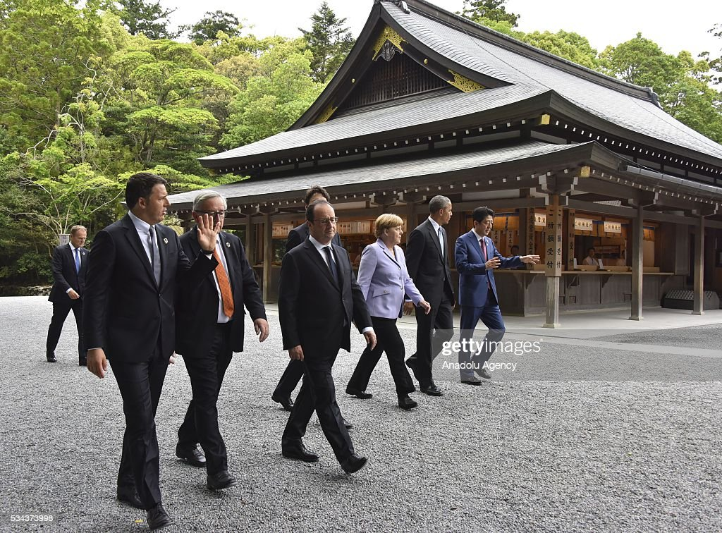 Italian Prime Minister Matteo Renzi, European Commission President Jean-Claude Juncker, French President Francois Hollande, Canadian Prime Minister Justin Trudeau, German Chancellor Angela Merkel, US President Barack Obama, and Japanese Prime Minister Shinzo Abe walk past the Kaguraden as they visit Ise-Jingu Shrine during the first day of the G7 leaders summit in the city of Ise in Mie prefecture, Japan on May 26, 2016.