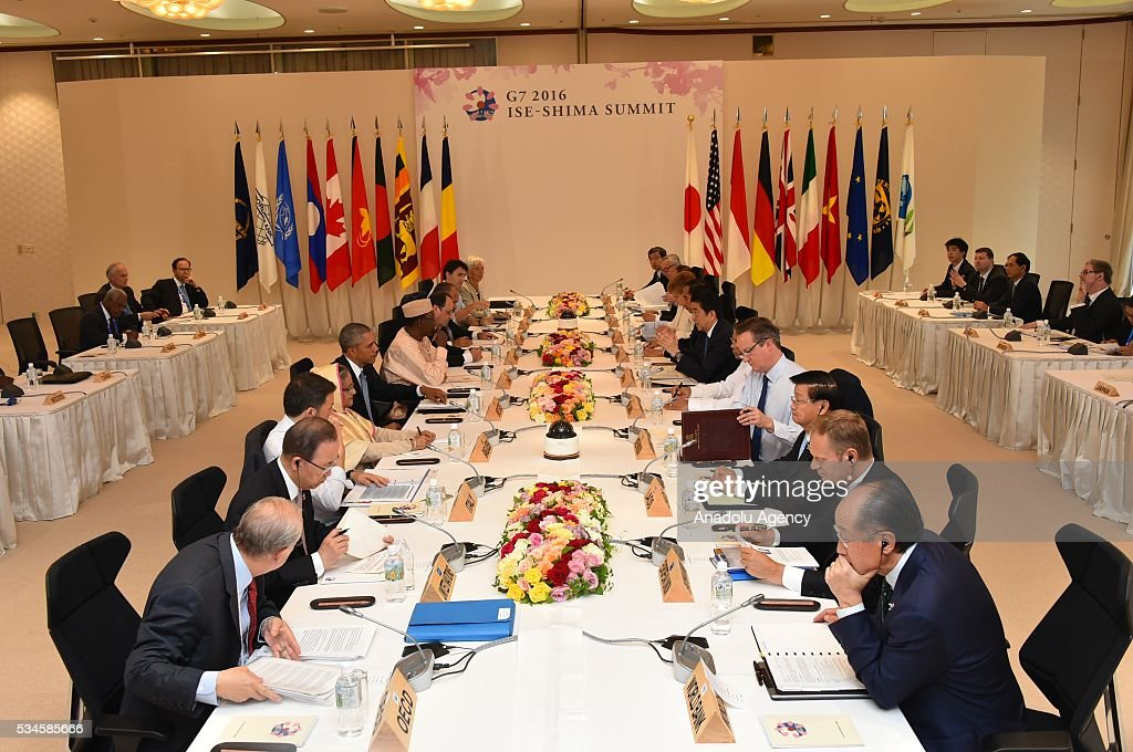 Italian Prime Minister Matteo Renzi (L-3), European Council President Donald Tusk (R-2), British Prime Minister David Cameron (R-4), U.S. President Barack Obama (L-5), Canadian Prime Minister Justin Trudeau (L-10), European Commission President Jean-Claude Juncker (R-9), Japanese Prime Minister Shinzo Abe (R-6), UN Secretary General Ban Ki-moon (L-2) and French President Francois Hollande (L-8) attend a meeting during the G7 leaders summit at the Shima Kanko Hotel in Ise, Japan on May 26, 2016.