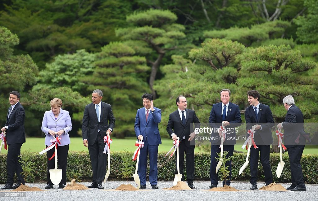Italian Prime Minister Matteo Renzi, German Chancellor Angela Merkel, US President Barack Obama, Japan's Prime Minister Shinzo Abe, French President Francois Hollande, Britain's Prime Minister David Cameron, Canadian Prime Minister Justin Trudeau and European Commission President Jean-Claude Juncker take part in a ceremony on the grounds at Ise-Jingu Shrine in the city of Ise in Mie prefecture, on May 26, 2016 on the first day of the G7 leaders summit. World leaders kick off two days of G7 talks in Japan on May 26 with the creaky global economy, terrorism, refugees, China's controversial maritime claims, and a possible Brexit headlining their packed agenda. / AFP / STEPHANE