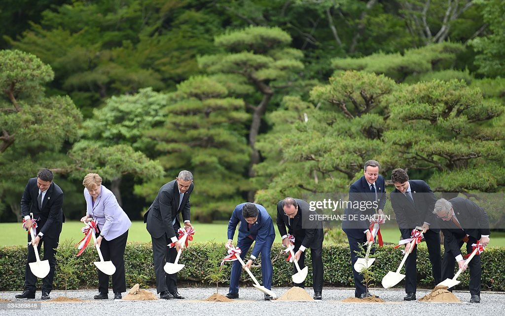 Italian Prime Minister Matteo Renzi, German Chancellor Angela Merkel, US President Barack Obama, Japan's Prime Minister Shinzo Abe, French President Francois Hollande, Britain's Prime Minister David Cameron, Canadian Prime Minister Justin Trudeau and European Commission President Jean-Claude Juncker take part in a tree planting ceremony on the grounds at Ise-Jingu Shrine in the city of Ise in Mie prefecture, on May 26, 2016 on the first day of the G7 leaders summit. World leaders kicked off two days of G7 talks in Japan on May 26 with the creaky global economy, terrorism, refugees, China's controversial maritime claims, and a possible Brexit headlining their packed agenda. / AFP / STEPHANE
