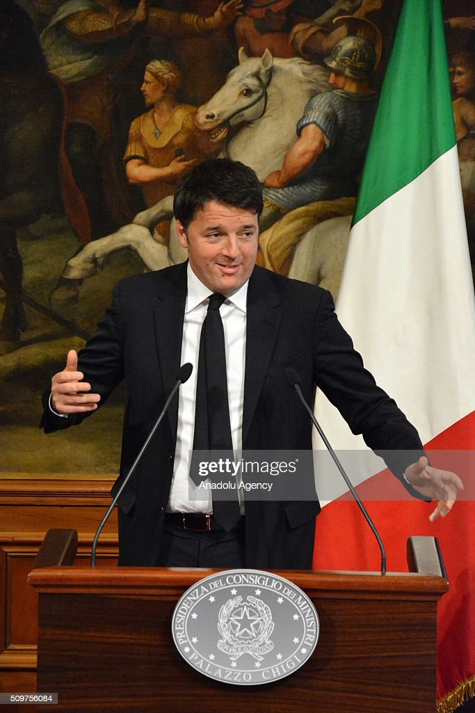 Italian Prime Minister Matteo Renzi gestures after he took his mobile phone back as he dropped it to floor during a joint press at Chigi palace in Rome, Italy on February 12, 2016.