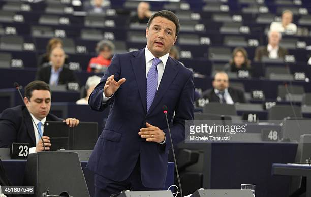 Italian Prime Minister Matteo Renzi gestures as he delivers a speech to the plenary room in the European Parliament ahead of the beginning of the...
