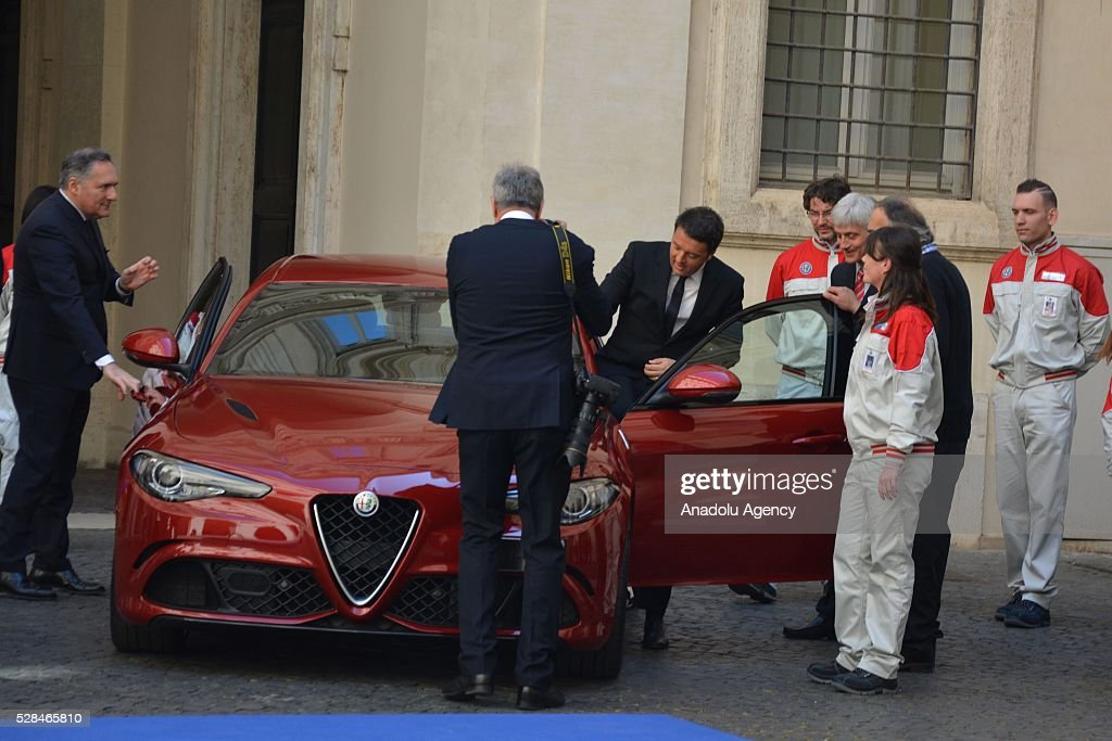 Italian Prime Minister Matteo Renzi (C) gets in the car during Italian automotive company Fiat-Chrysler Group (FCA) introduces Alfa Romeo's new brand sports car 'Giulia' with a ceremony at the yard of Chigi palace in Rome, Italy on May 5, 2016.