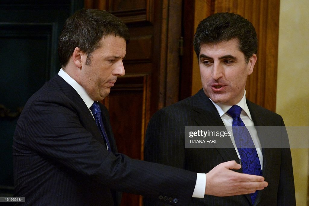 Italian Prime Minister <a gi-track='captionPersonalityLinkClicked' href=/galleries/search?phrase=Matteo+Renzi&family=editorial&specificpeople=6689301 ng-click='$event.stopPropagation()'>Matteo Renzi</a> (L) greets prime minister of Iraq's Kurdistan regional government <a gi-track='captionPersonalityLinkClicked' href=/galleries/search?phrase=Nechirvan+Barzani&family=editorial&specificpeople=582951 ng-click='$event.stopPropagation()'>Nechirvan Barzani</a> before their meeting on March 2, 2015 at the Chigi Palace in Rome.