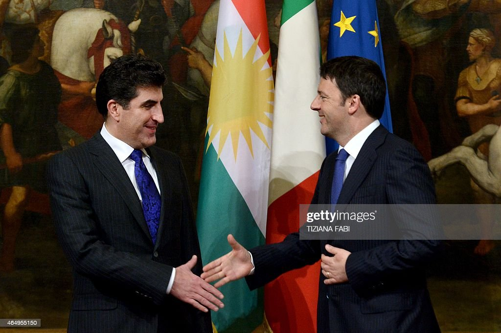 Italian Prime Minister <a gi-track='captionPersonalityLinkClicked' href=/galleries/search?phrase=Matteo+Renzi&family=editorial&specificpeople=6689301 ng-click='$event.stopPropagation()'>Matteo Renzi</a> greets prime minister of Iraq's Kurdistan regional government <a gi-track='captionPersonalityLinkClicked' href=/galleries/search?phrase=Nechirvan+Barzani&family=editorial&specificpeople=582951 ng-click='$event.stopPropagation()'>Nechirvan Barzani</a> before their meeting on March 2, 2015 at the Chigi Palace in Rome.
