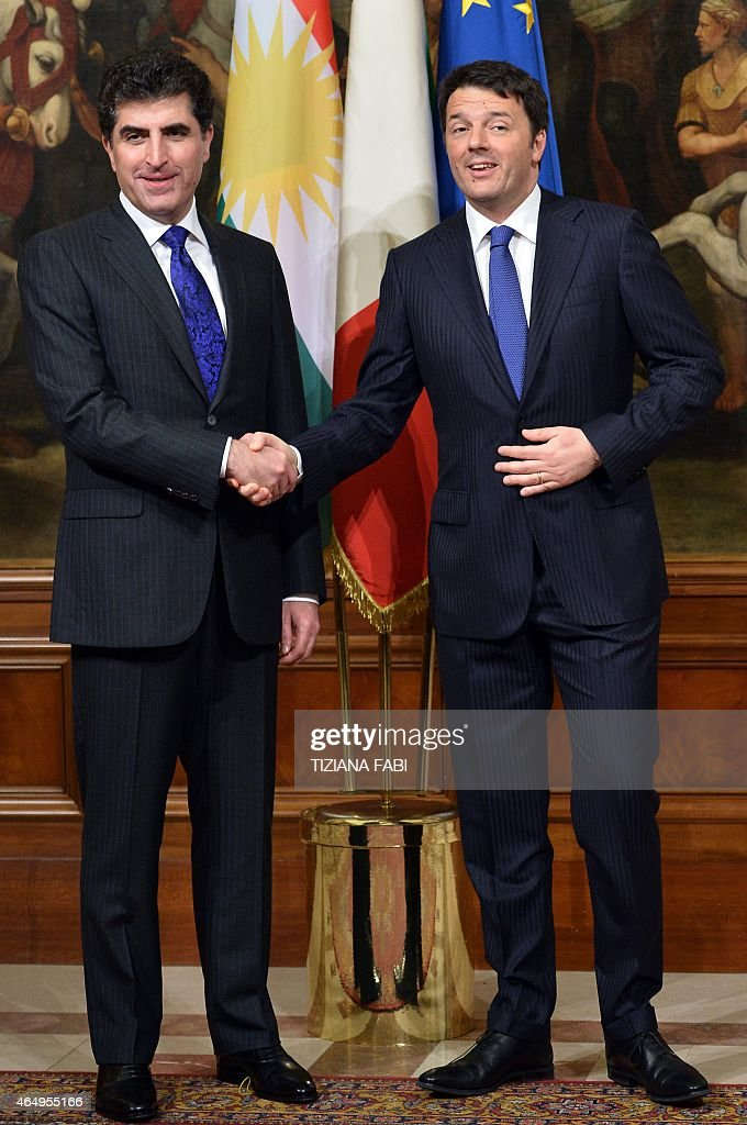 Italian Prime Minister <a gi-track='captionPersonalityLinkClicked' href=/galleries/search?phrase=Matteo+Renzi&family=editorial&specificpeople=6689301 ng-click='$event.stopPropagation()'>Matteo Renzi</a> (R) greets prime minister of Iraq's Kurdistan regional government <a gi-track='captionPersonalityLinkClicked' href=/galleries/search?phrase=Nechirvan+Barzani&family=editorial&specificpeople=582951 ng-click='$event.stopPropagation()'>Nechirvan Barzani</a> before their meeting on March 2, 2015 at the Chigi Palace in Rome.