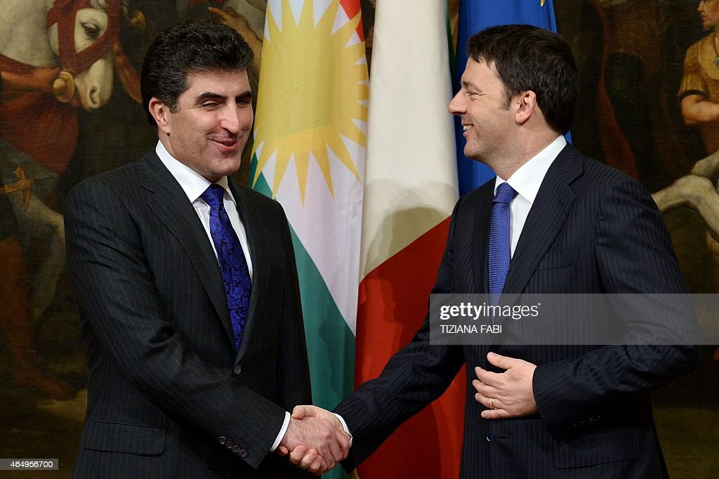 Italian Prime Minister <a gi-track='captionPersonalityLinkClicked' href=/galleries/search?phrase=Matteo+Renzi&family=editorial&specificpeople=6689301 ng-click='$event.stopPropagation()'>Matteo Renzi</a> (R) greets prime minister of Iraq's Kurdistan regional government <a gi-track='captionPersonalityLinkClicked' href=/galleries/search?phrase=Nechirvan+Barzani&family=editorial&specificpeople=582951 ng-click='$event.stopPropagation()'>Nechirvan Barzani</a> before their meeting on March 2, 2015 at the Palazzo Chigi in Rome.