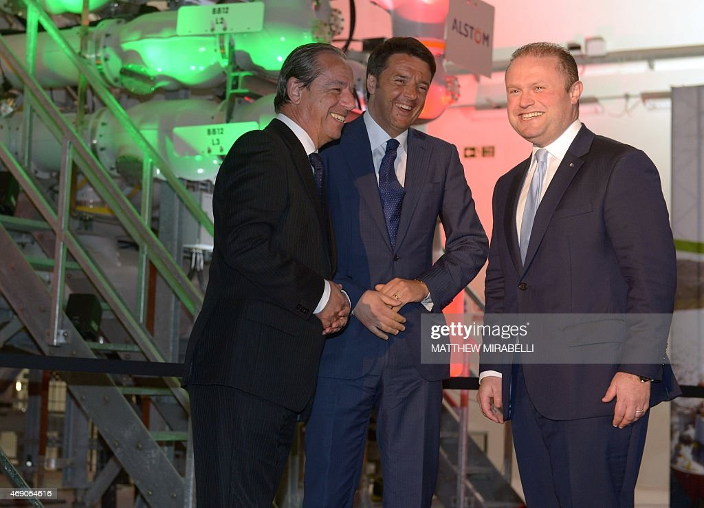 Italian Prime Minister <a gi-track='captionPersonalityLinkClicked' href=/galleries/search?phrase=Matteo+Renzi&family=editorial&specificpeople=6689301 ng-click='$event.stopPropagation()'>Matteo Renzi</a> (C), his Maltese counterpart Joseph Muscat (R) and former Maltese Prime Minister <a gi-track='captionPersonalityLinkClicked' href=/galleries/search?phrase=Lawrence+Gonzi&family=editorial&specificpeople=568017 ng-click='$event.stopPropagation()'>Lawrence Gonzi</a> (L) smile on April 9, 2015 during the launch of the Malta-Sicily interconnector project. The 120-kms (59 mile) long underwater cable starts in Malta and runs to Marina di Ragusa in Sicily, where it will be linked to the to the Italian network in the Terna substation. AFP PHOTO / Matthew Mirabelli - MALTA