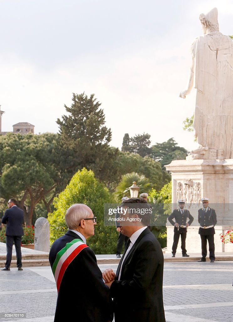 Italian Prime Minister Matteo Renzi (R) is welcomed by Rome's Commissioner Francesco Paolo Tronca as he arrives in Piazza del Campidoglio to attend a conference on the state of the European Union at the Capitoline Museum in Rome, May 5, 2016.