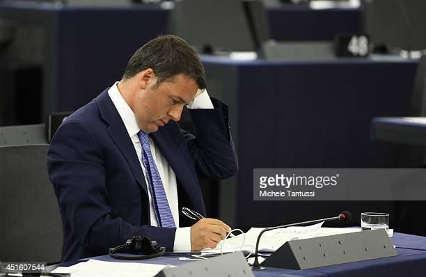 Italian Prime Minister Matteo Renzi listens in the european parliament ahead of the beginning of the sixmonth Italian presidency of the European...