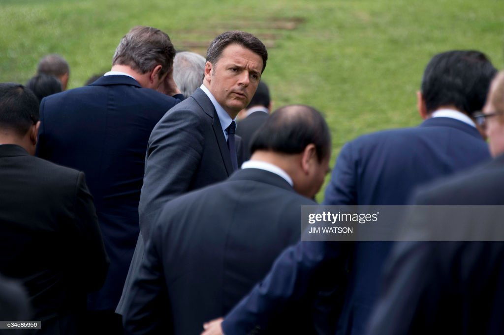 Italian Prime Minister Matteo Renzi (C) looks back as he departs after taking part in the 'Outreach Session' family photo with world leaders at the G7 Summit in Shima in Mie prefecture on May 27, 2016. A British secession from the European Union in next month's referendum could have disastrous economic consequences, G7 leaders warned on May 27 at the close of the summit in Japan. / AFP / POOL / JIM