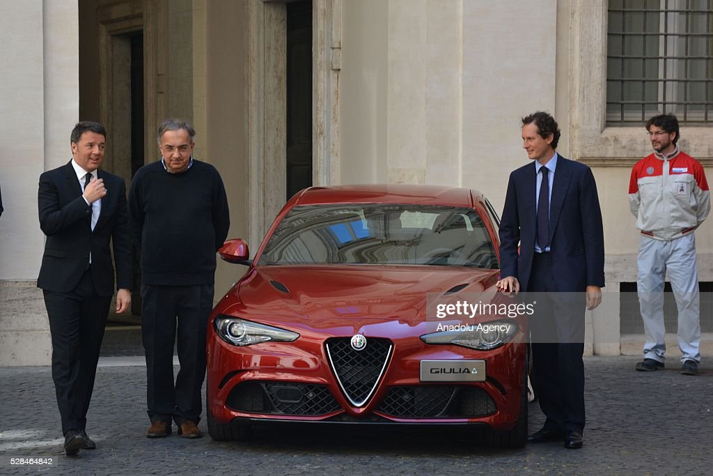 Italian Prime Minister Matteo Renzi (L), President of FCA John Elkann (R) and FCA's CEO Sergio Marchionne (C) pose for a photo during Italian automotive company Fiat-Chrysler Group (FCA) introduces Alfa Romeo's new brand sports car 'Giulia' with a ceremony at the yard of Chigi palace in Rome, Italy on May 5, 2016.