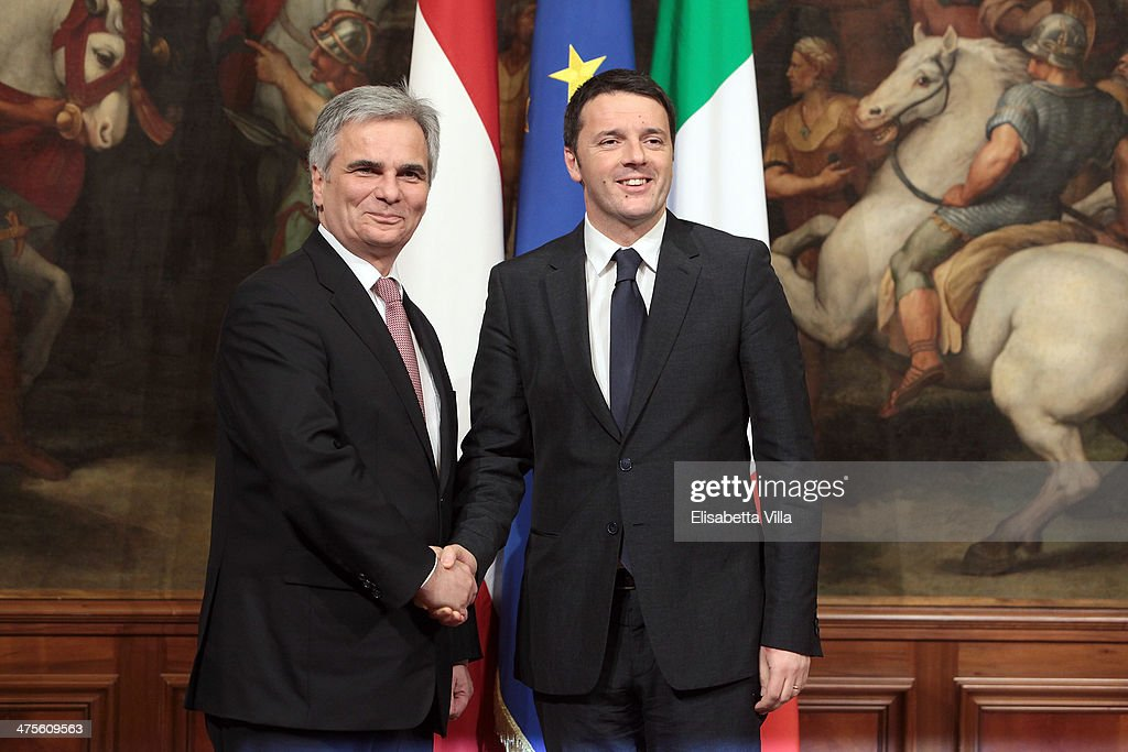 Italian Prime Minister <a gi-track='captionPersonalityLinkClicked' href=/galleries/search?phrase=Matteo+Renzi&family=editorial&specificpeople=6689301 ng-click='$event.stopPropagation()'>Matteo Renzi</a> (R) shakes hands with Austrian chancellor <a gi-track='captionPersonalityLinkClicked' href=/galleries/search?phrase=Werner+Faymann&family=editorial&specificpeople=4101130 ng-click='$event.stopPropagation()'>Werner Faymann</a> during a meeting at Palazzo Chigi on February 28, 2014 in Rome, Italy. The 39-year-old Renzi has promised a reform a month until June, including employment law, bureaucracy and taxation.