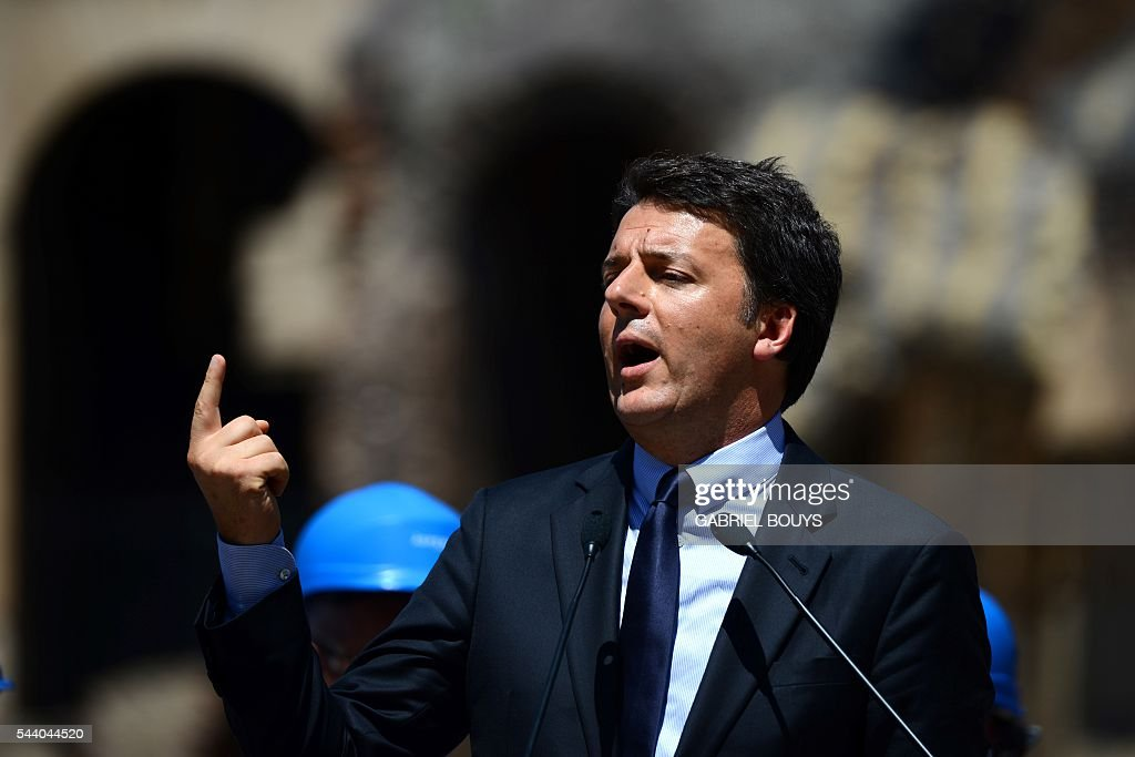 Italian Prime Minister Matteo Renzi speaks during a press conference on July 1, 2016 in Rome to announce the end of the restoration of the façade of the Colosseum financed by top luxury brands. / AFP / GABRIEL