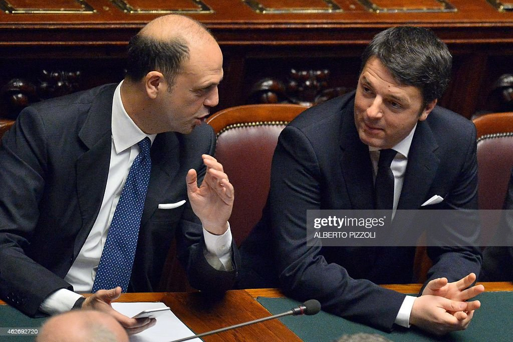 Italian Prime Minister Matteo Renzi speaks with Interior Minister Angelino Alfano at the Parliament before the arrival of newly elected President...