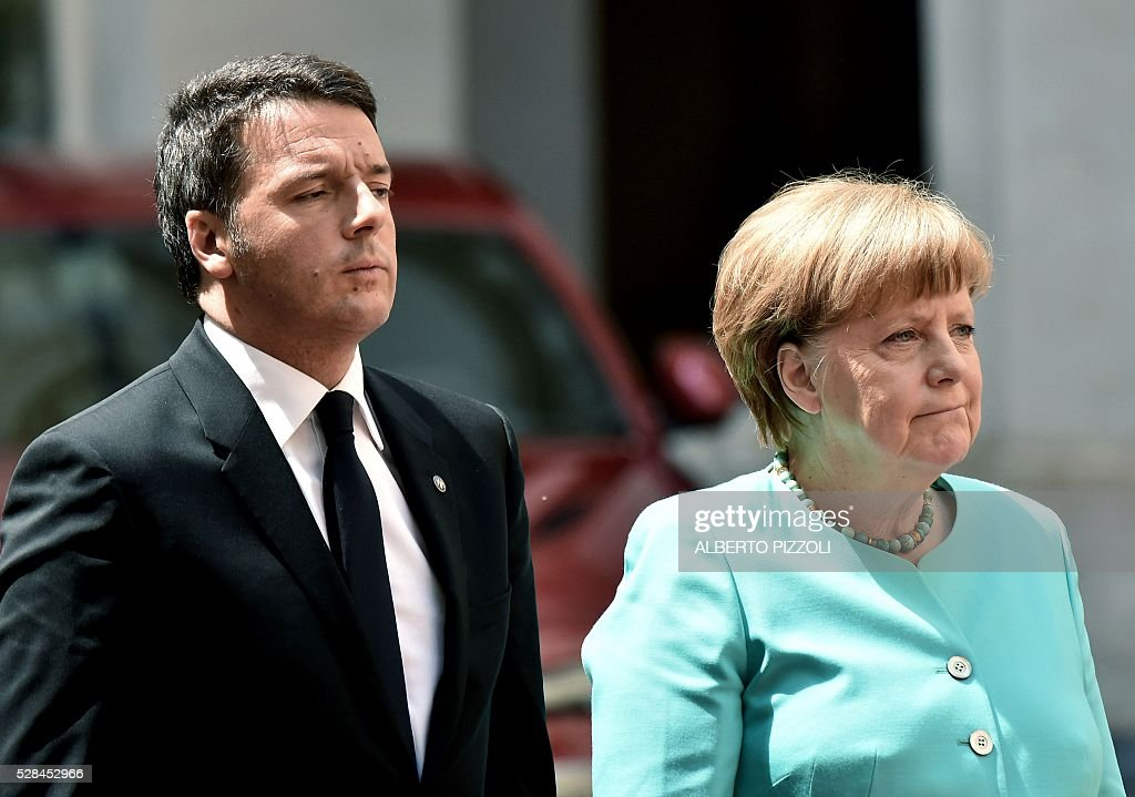 Italian Prime Minister Matteo Renzi (L) stands next to German Chancellor Angela Merkel upon her arrival at Rome's Palazzo Chigi on May 5, 2016. EU president Donald Tusk travels to Rome Thursday with fellow EU institution leaders and German Chancellor Angela Merkel for two days of talks likely to focus on next steps in Europe's migrant crisis. Prime Minister Matteo Renzi, who fears Italy becoming the new migrant frontline after the closure of the Balkan route, will host the first day of talks, followed by Pope Francis on Friday. PIZZOLI