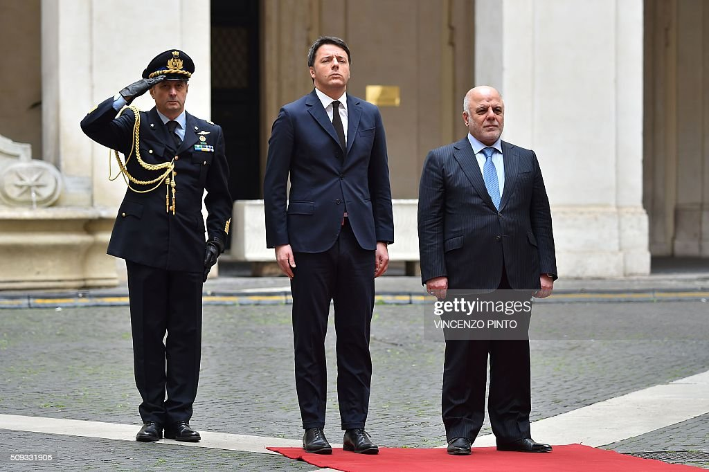 Italian Prime Minister Matteo Renzi (C) welcomes Iraq's Prime Minister Haider al-Abadi before their meeting on February 10, 2016 at the Palazzo Chigi in Rome. / AFP / VINCENZO PINTO
