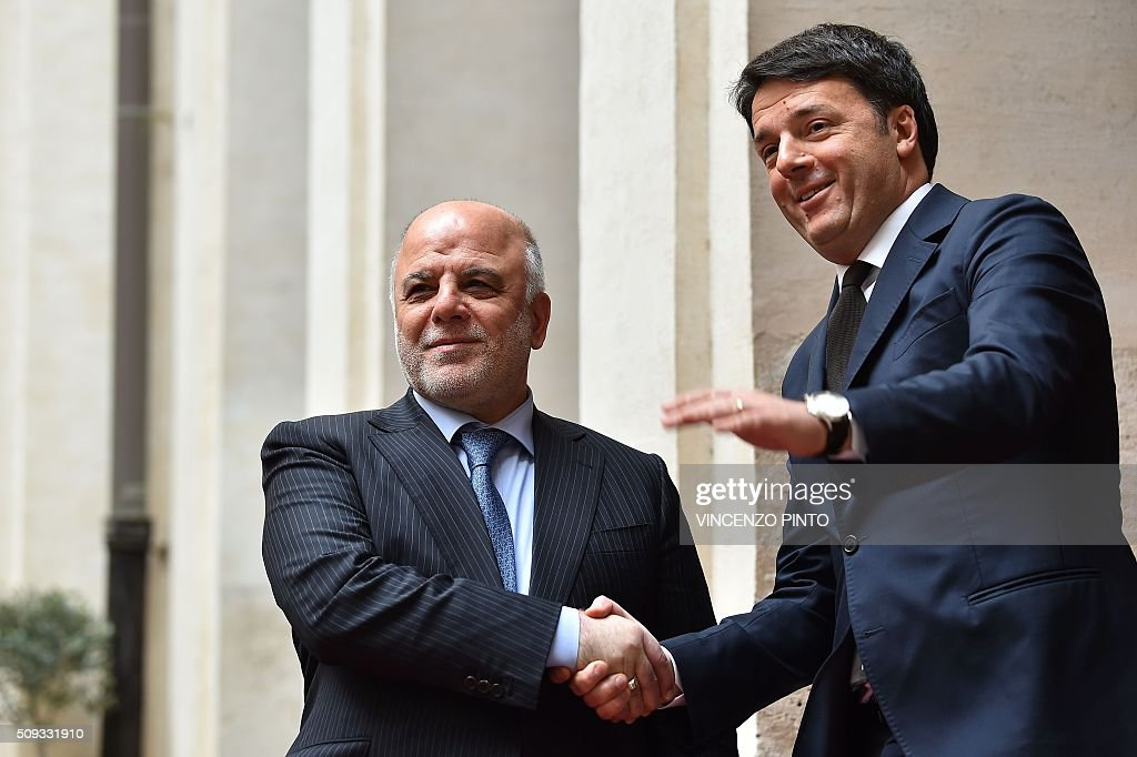 Italian Prime Minister Matteo Renzi (R) welcomes Iraq's Prime Minister Haider al-Abadi before their meeting on February 10, 2016 at the Palazzo Chigi in Rome. / AFP / VINCENZO PINTO