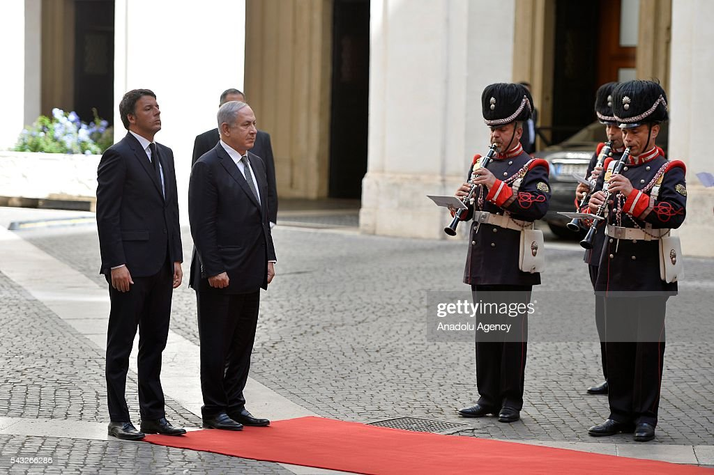 Italian Prime Minister Matteo Renzi (L) welcomes Israeli Prime Minister Benjamin Netanyahu (R) with an official ceremony at the courtyard of the Palazzo Chigi in Rome, Italy on June 27, 2016.