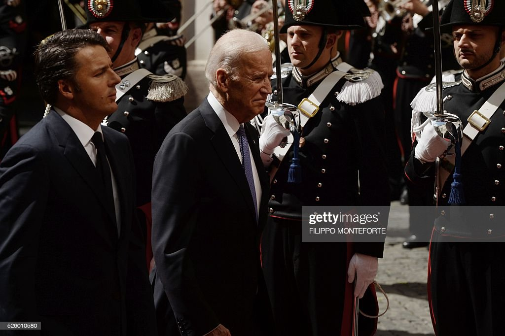 Italian Prime Minister Matteo Renzi (L) welcomes US Vice-President Joe Biden prior their meeting on April 29, 2016 at the Palazzo Chigi in Rome. Earlier today, Biden, whose 46-year old son Beau Biden died from brain cancer last year, made an emotional speech at a stem cell summit thanking Pope Francis for his support and for counselling his family during his visit to the United States. / AFP / Filippo MONTEFORTE